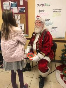 Visit from Santa during the annual shopping spree at Kohl's